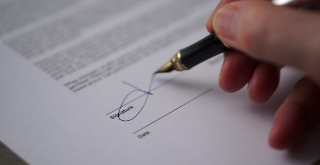 stock-footage-document-signature-paper-signature-signing-a-printed-form-signature-on-agreement-to-sign-a